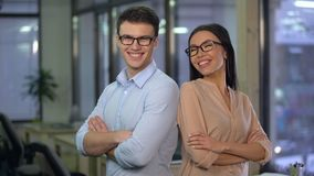 Cheerful employees posing for camera, work for young and energetic people, team stock footage