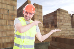 Cheerful engineer holding something in his palm Stock Photography