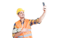 Cheerful engineer with yellow helmet taking a selfie Royalty Free Stock Photos