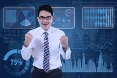 Cheerful entrepreneur with financial graph Royalty Free Stock Photo