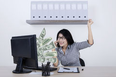 Cheerful entrepreneur with money on monitor Royalty Free Stock Images