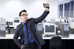 Cheerful entrepreneur taking self portrait Stock Photo