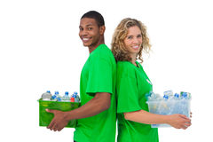 Cheerful environmental activists holding box of recyclables and Stock Photography