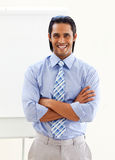 Cheerful ethnic businessman in front of a board Royalty Free Stock Photography