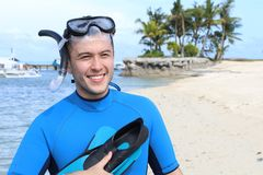 Cheerful ethnic male about to dive in the Ocean.  Stock Images