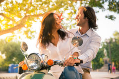 Cheerful european couple flirting on scooter Stock Image