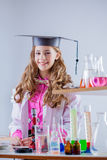 Cheerful excellent student posing in chemistry lab Royalty Free Stock Photo