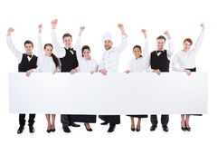 Cheerful Excited Catering Staff Showing Banner Royalty Free Stock Photo