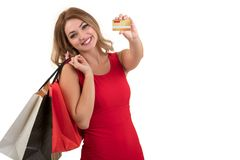 Cheerful excited surprised young woman with credit card over white background.  Royalty Free Stock Image