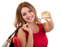 Cheerful excited surprised young woman with credit card over white background stock image