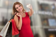 Cheerful excited surprised young woman with credit card with sale illustration.  Royalty Free Stock Photography