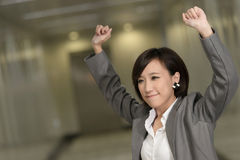 Cheerful and exciting business woman. Of Asian inside of modern buildings Royalty Free Stock Photography