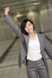 Cheerful and exciting business woman. Of Asian inside of modern buildings Royalty Free Stock Image