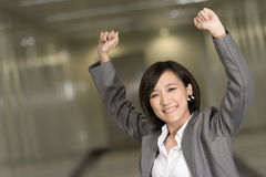 Cheerful and exciting business woman. Of Asian inside of modern buildings Royalty Free Stock Photos