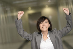 Cheerful and exciting business woman. Of Asian inside of modern buildings Royalty Free Stock Photo
