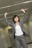 Cheerful and exciting business woman. Of Asian inside of modern buildings Stock Photography