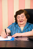 Cheerful executive elderly writting Royalty Free Stock Photo