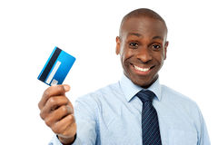 Cheerful executive holding credit card Stock Image