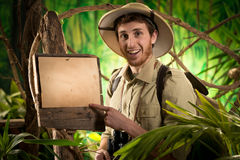 Cheerful explorer with sign Royalty Free Stock Images