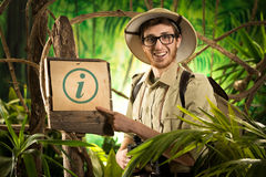 Cheerful explorer with sign Stock Image