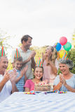 Cheerful extended family clapping for little girls birthday Royalty Free Stock Photography