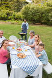 Cheerful extended family having a barbecue Royalty Free Stock Photo