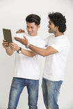 Cheerful face college students using digital tablet Stock Photos