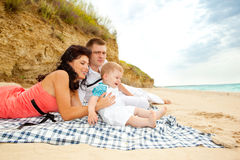 Cheerful family. A cheerful family playing on the beach Royalty Free Stock Photos