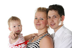 Cheerful family. The happy young family with the small child looks forward Stock Photo