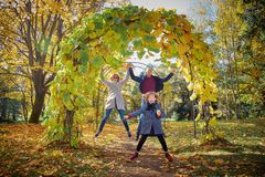 Cheerful family in the autumn park royalty free stock images