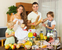 Cheerful family with bags of food Royalty Free Stock Photography