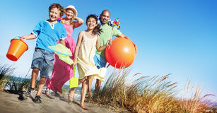 Cheerful Family Bonding by the Beach Holiday Concept Stock Images