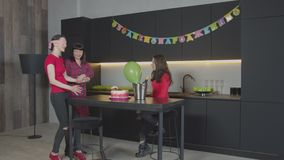 Cheerful family celebrating Birthday in home kitchen stock footage