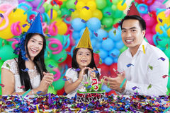 Cheerful family celebrating birthday party Stock Images