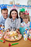 Cheerful family celebrating mother's birthday Royalty Free Stock Photo