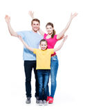 Cheerful family with child raised hands up. Young happy cheerful family with child raised hands up - isolated on white background Royalty Free Stock Photo