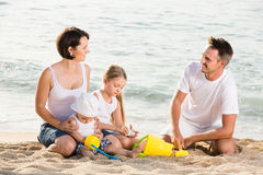 Cheerful family with children playing at beach Stock Photos