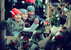 Cheerful family chooses gifts for the Christmas holidays Royalty Free Stock Photography