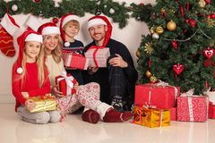 Cheerful family with Christmas gifts stock images