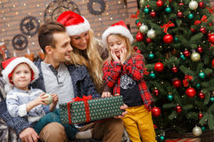 Cheerful family with Christmas gifts Royalty Free Stock Photography