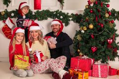 Cheerful family with Christmas gifts stock image