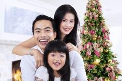 Cheerful family and christmas tree Royalty Free Stock Photo