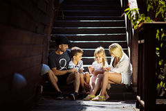 Cheerful family dad mom son and daughter royalty free stock photo