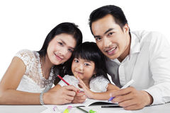 Cheerful family doing schoolwork together Stock Image