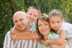 Cheerful family in early fall park Stock Image
