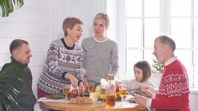 Cheerful family eating christmas meal. In the kitchen stock footage