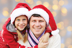 Cheerful family embracing . Merry Christmas. Royalty Free Stock Photography