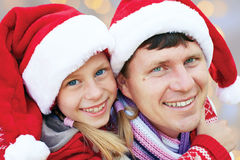 Cheerful family embracing near a Christmas tree. Merry Christmas Stock Photography