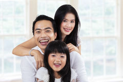 Cheerful family enjoy holiday at home Stock Photography