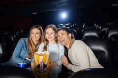 Cheerful Family Enjoying Film In Theater Royalty Free Stock Photos